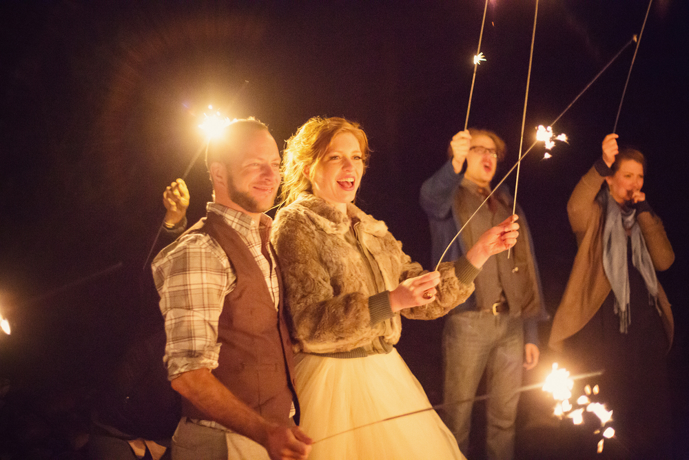 Ella Sophie Wedding Photography couple and guests holding long sparklers