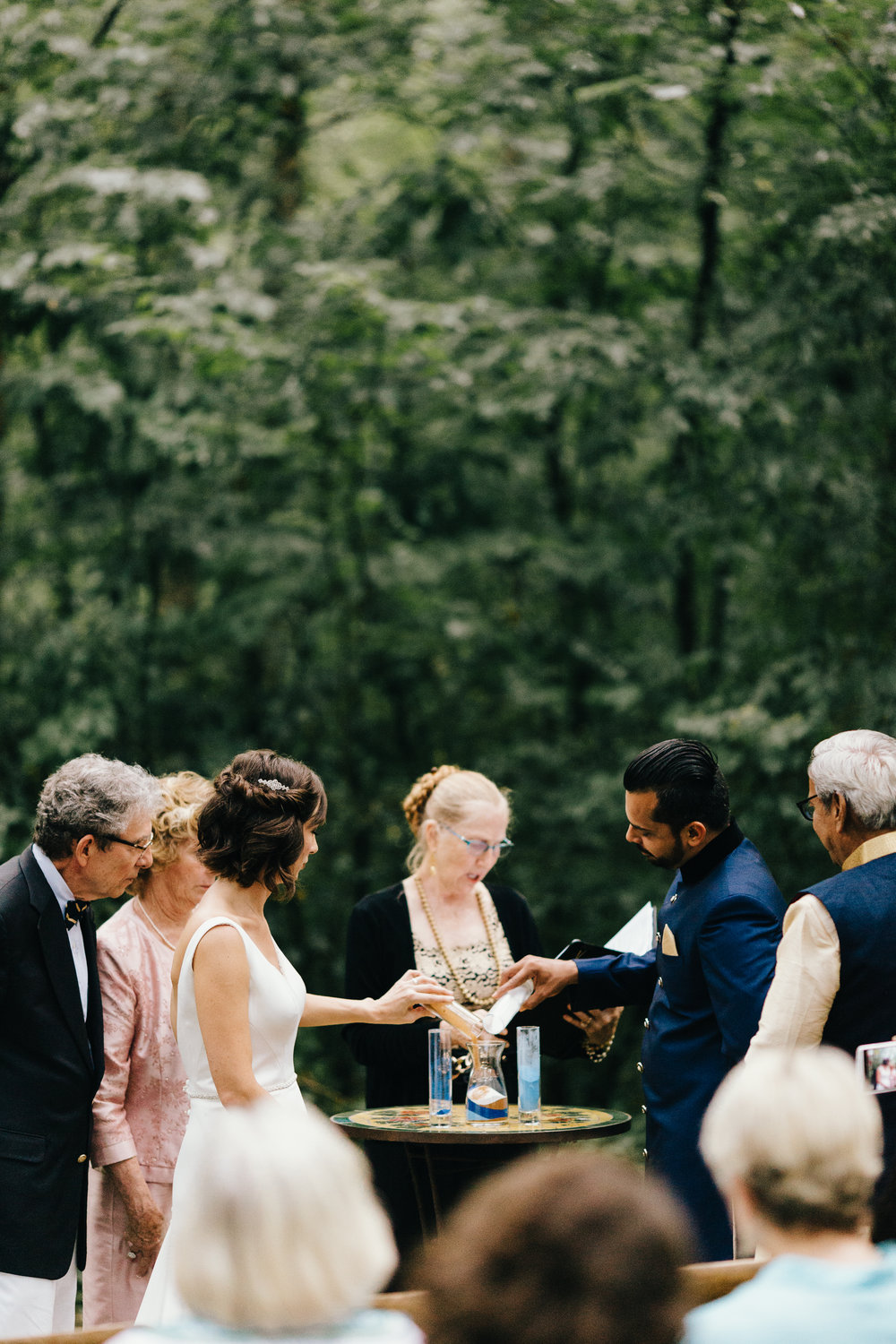 Erin Morrison Photography Tennessee couple pouring champagne into vase at altar