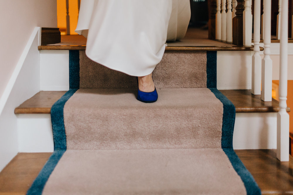 Erin Morrison Photography Tennessee bride descending stairs in blue high heels
