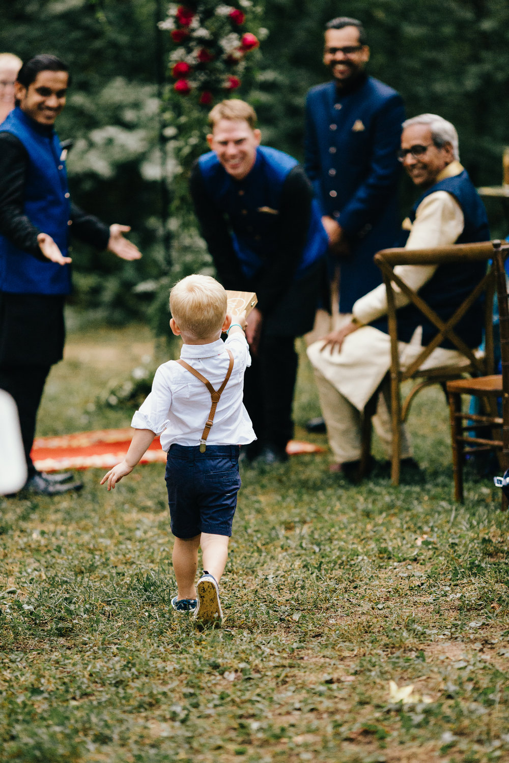 Erin Morrison Photography Tennessee ring bearer running to groomsmen