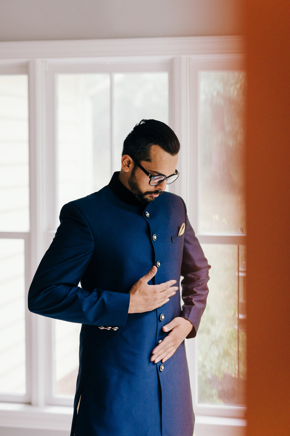 Erin Morrison Photography Tennessee groom smoothing jacket