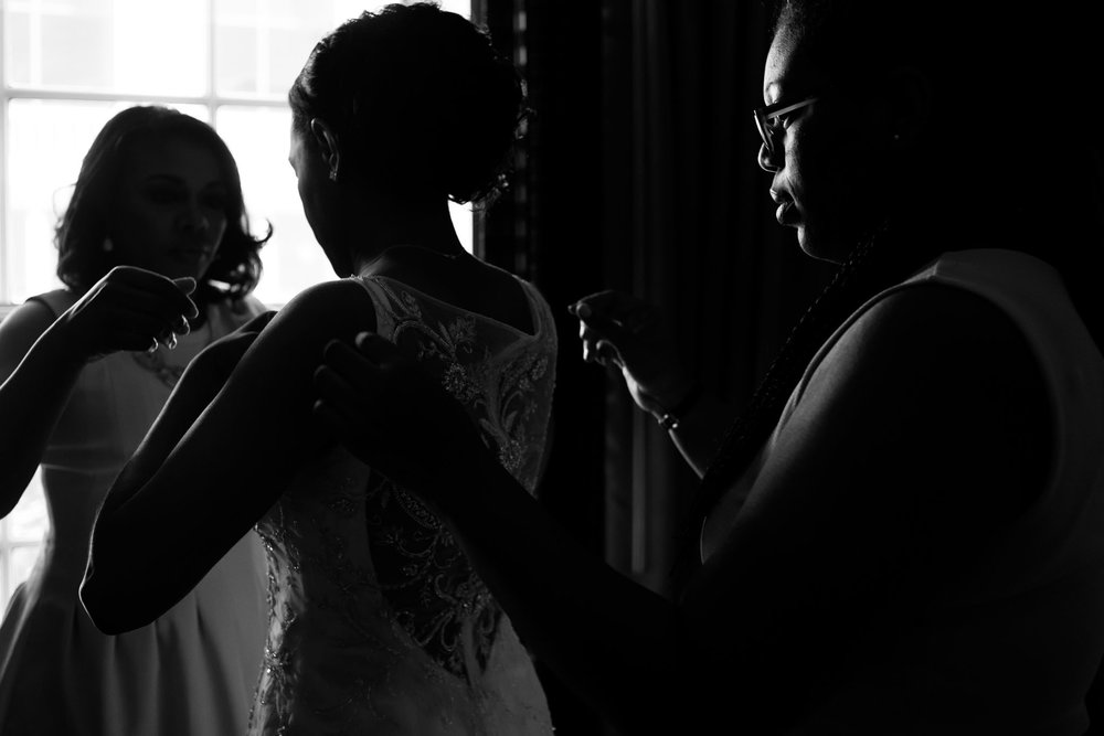 The Madious Wedding Photography DC bride being helped with dress