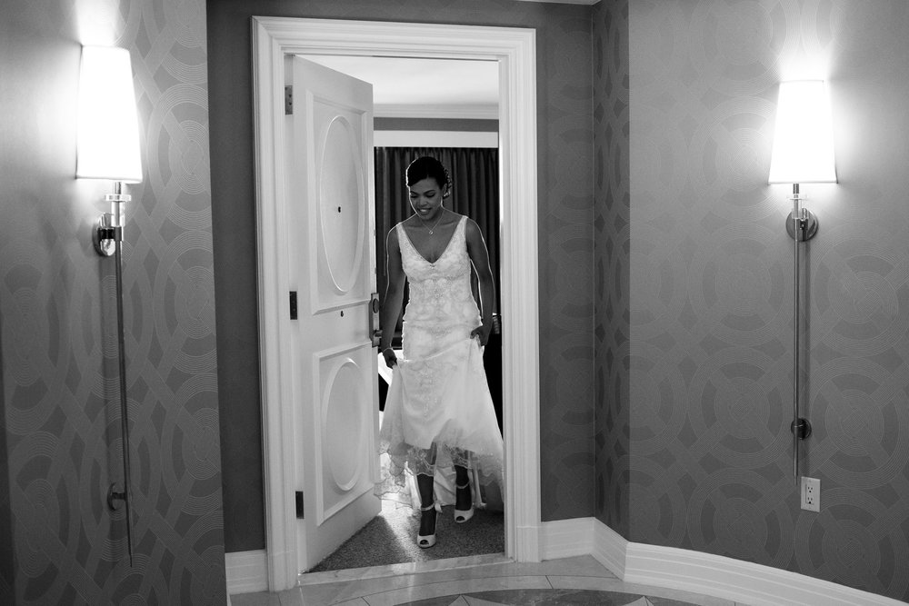 The Madious Wedding Photography DC bride stepping out of room