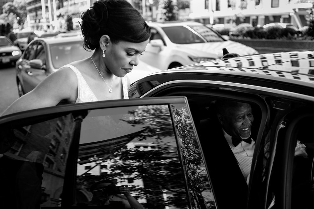 The Madious Wedding Photography DC bride getting into car