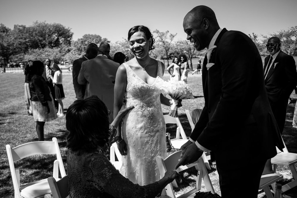 The Madious Wedding Photography DC greeting guests as married couple