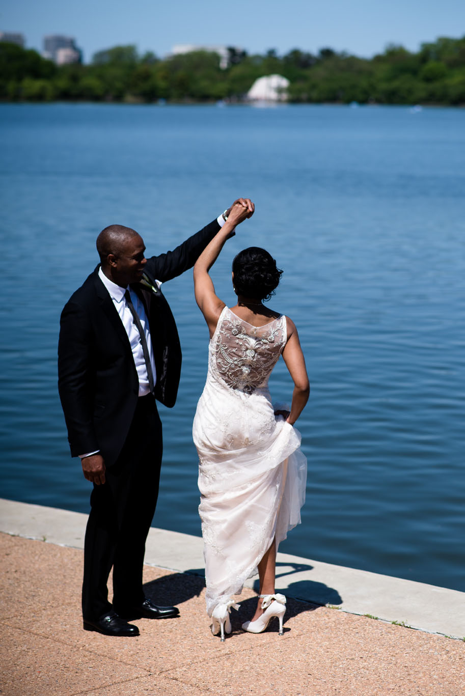 The Madious Wedding Photography DC groom twirling bride by the water