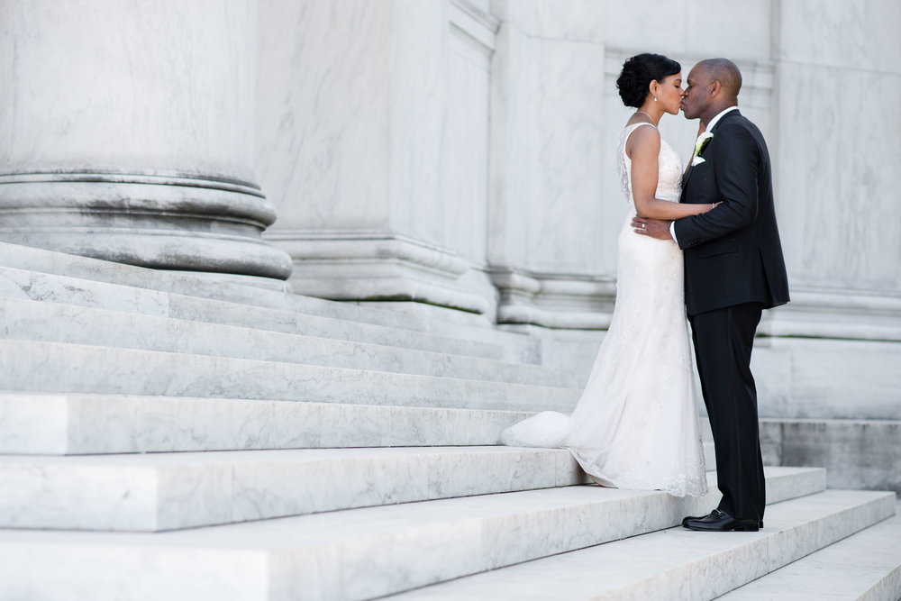 The Madious Wedding Photography DC kiss on lincoln memorial steps