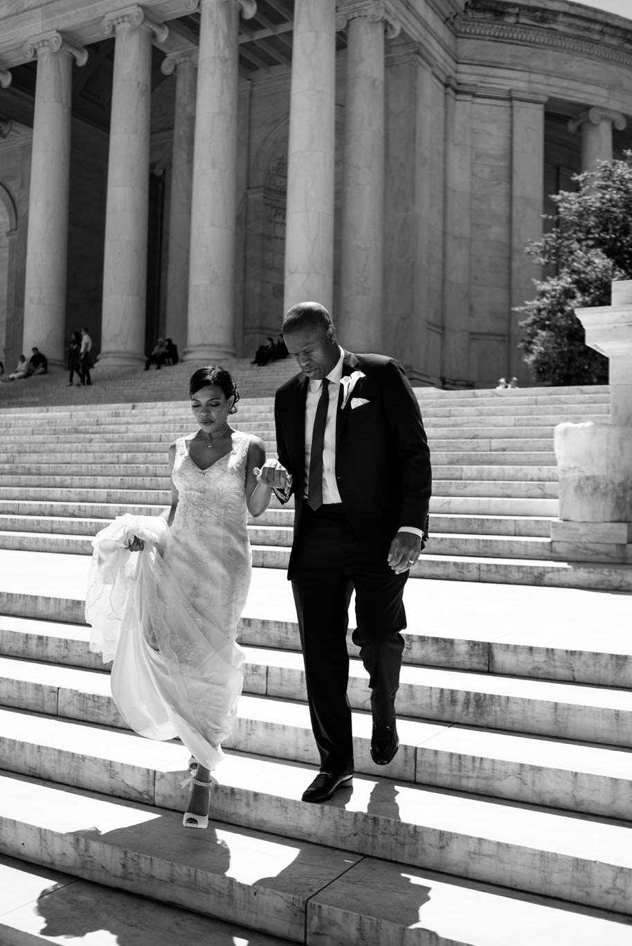 The Madious Wedding Photography DC couple descending steps