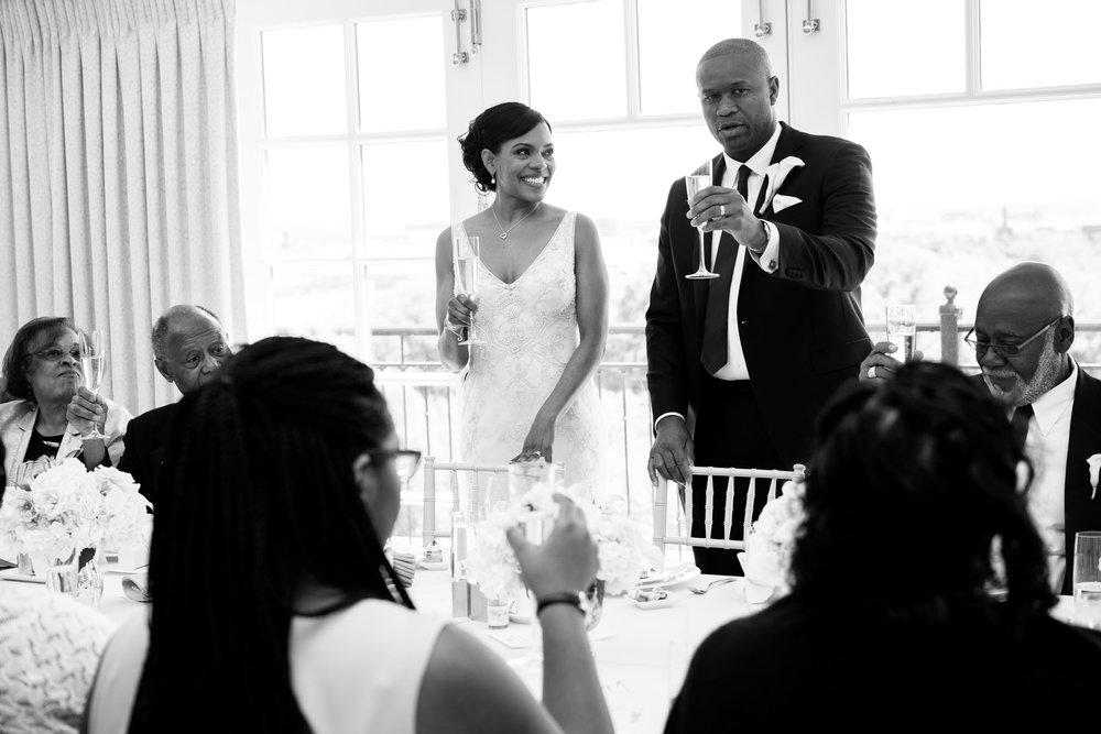 The Madious Wedding Photography DC groom leading wedding toast