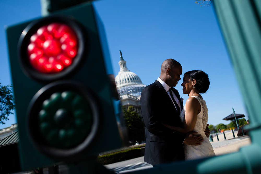 The Madious Wedding Photography DC photo of couple from behind pedestrian light