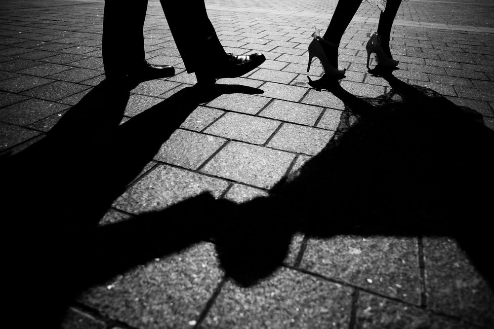 The Madious Wedding Photography DC shadows of bride and groom walking