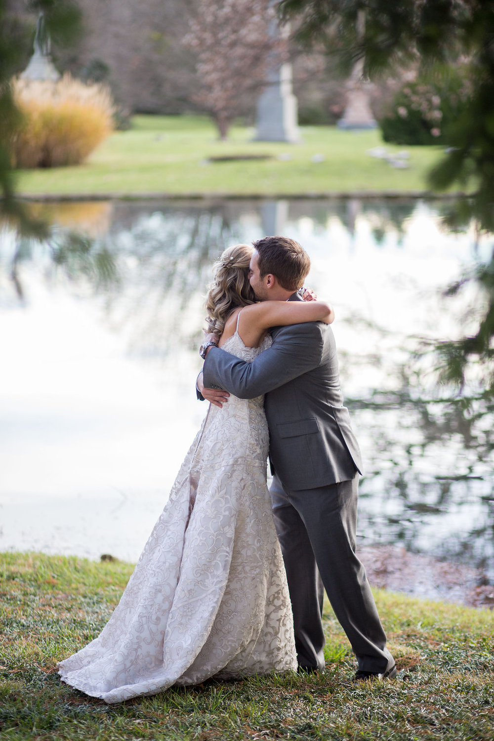 Corey and Alex Larrison Wedding Photography Cincinnati Couple hugging beside lake