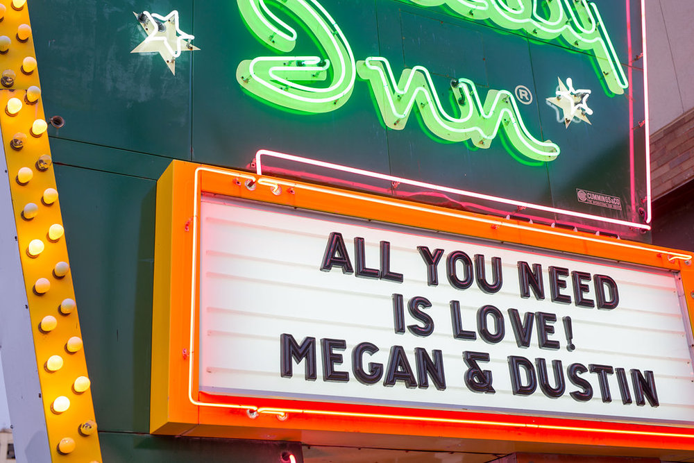 "Corey and Alex Larrison Wedding Photography Cincinnati neon sigh reading ""All You Need Is Love! Megan & Dustin"""