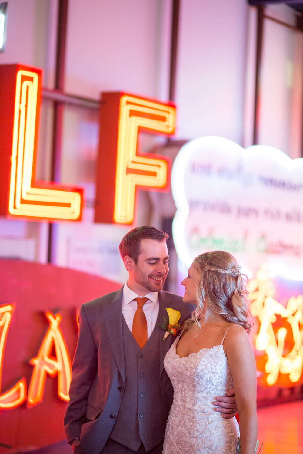Corey and Alex Larrison Wedding Photography Cincinnati couple and signs