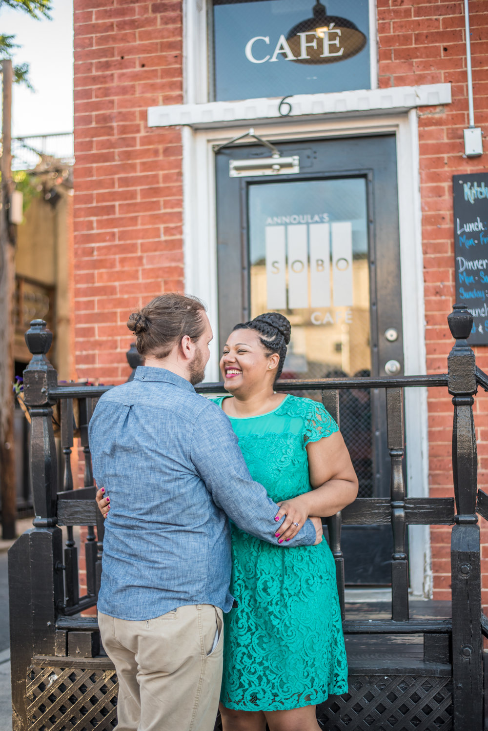 Ronnie Bliss Wedding Photography Baltimore Maryland embrace in front of café