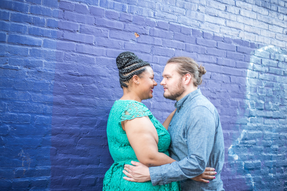 Ronnie Bliss Wedding Photography Baltimore Maryland embrace in front of brick wall