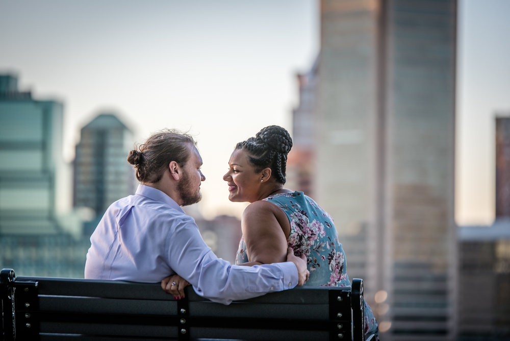 Ronnie Bliss Wedding Photography Baltimore Maryland sitting on park bench in front of skyline