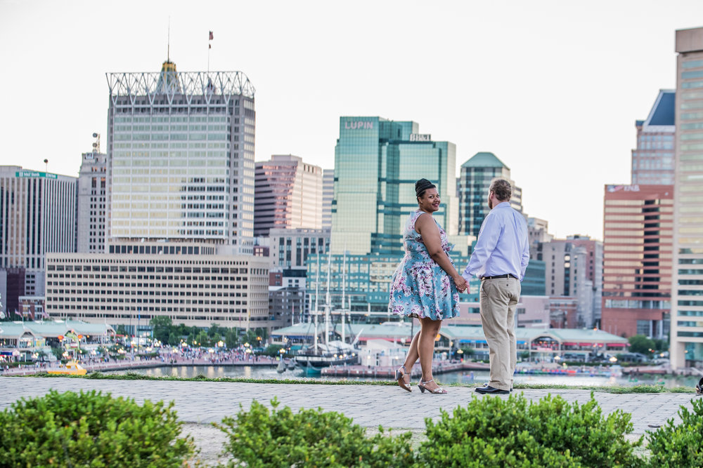 Ronnie Bliss Wedding Photography Baltimore Maryland holding hands in front of skyline