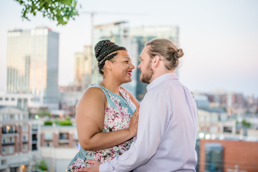 Ronnie Bliss Wedding Photography Baltimore Maryland embrace in front of skyline
