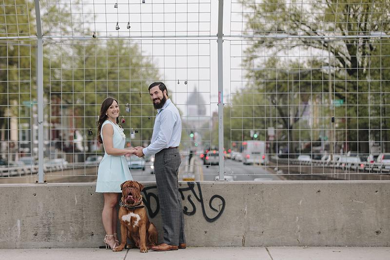 Erika Nizborski Wedding Photography DC couple holding hands on bridge with dog sitting between them