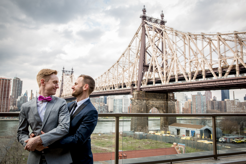 Justin McCallum Wedding Photography New York embracing with bridge backdrop