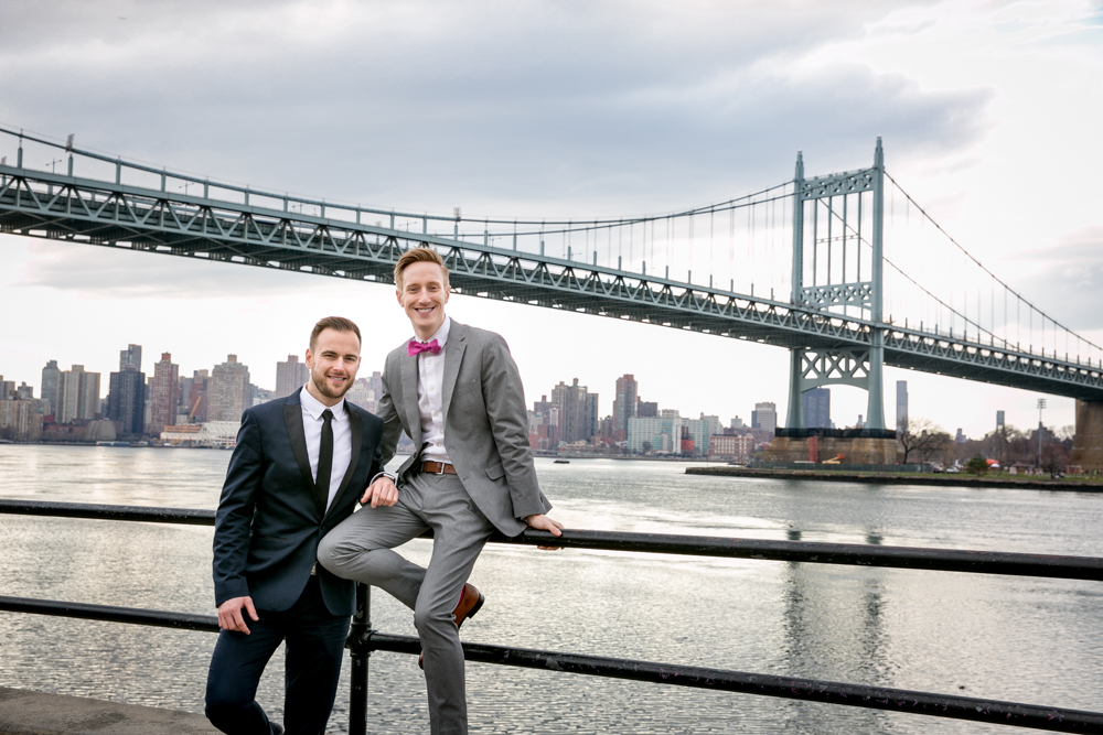 Justin McCallum Wedding Photography New York leaning on railing by river
