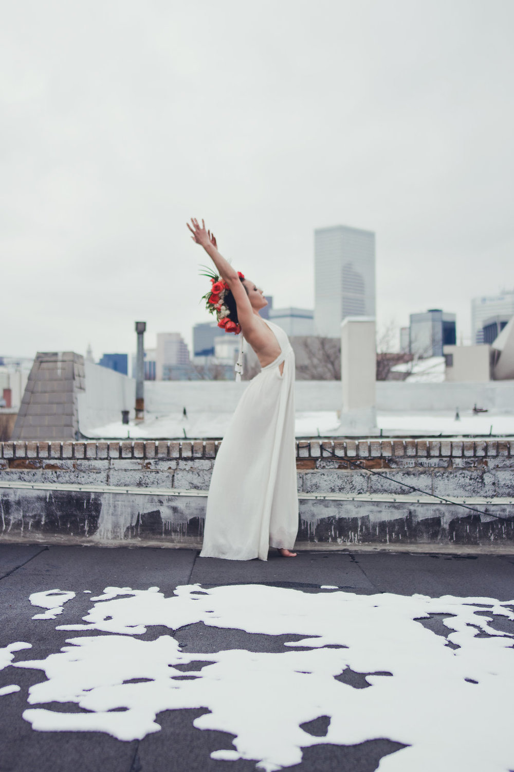 Lisa Rundall Wedding Photography Colorado model stretching back on snowy roof