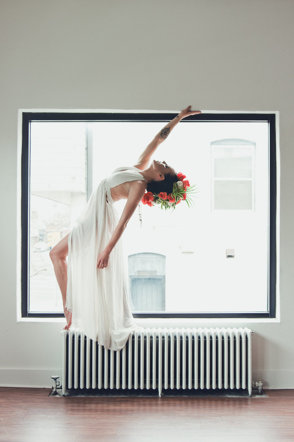 Lisa Rundall Wedding Photography Colorado model balancing on wall heater