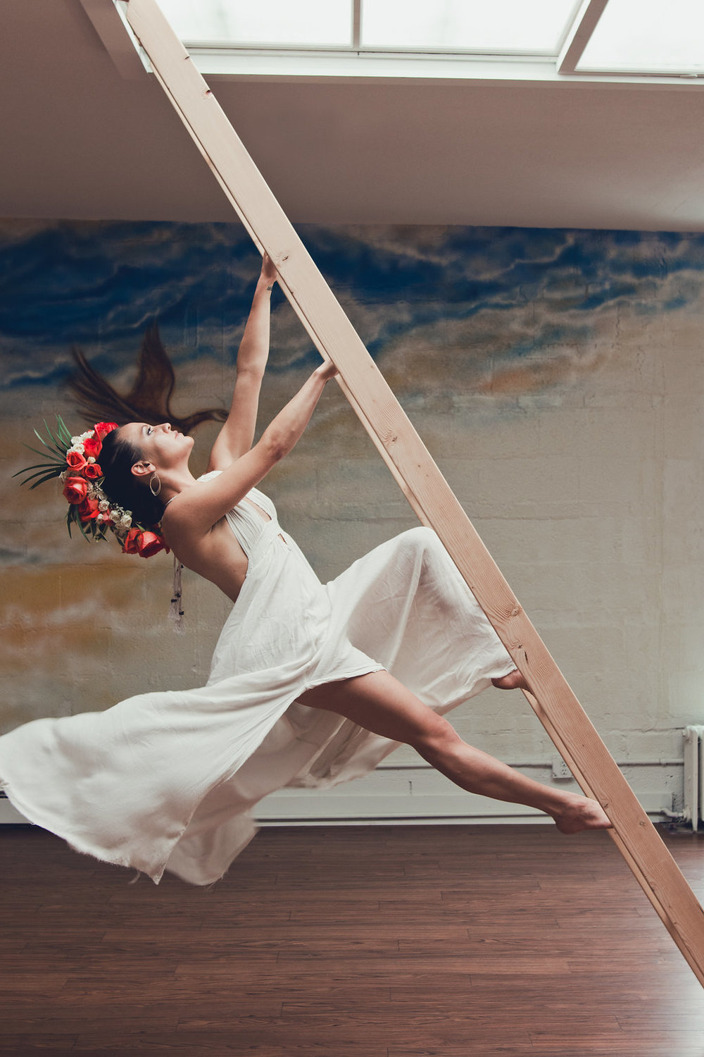 Lisa Rundall Wedding Photography Colorado model climbing back of ladder