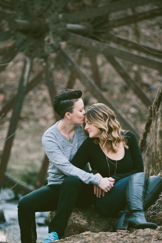 woman kissing fiancée's forehead