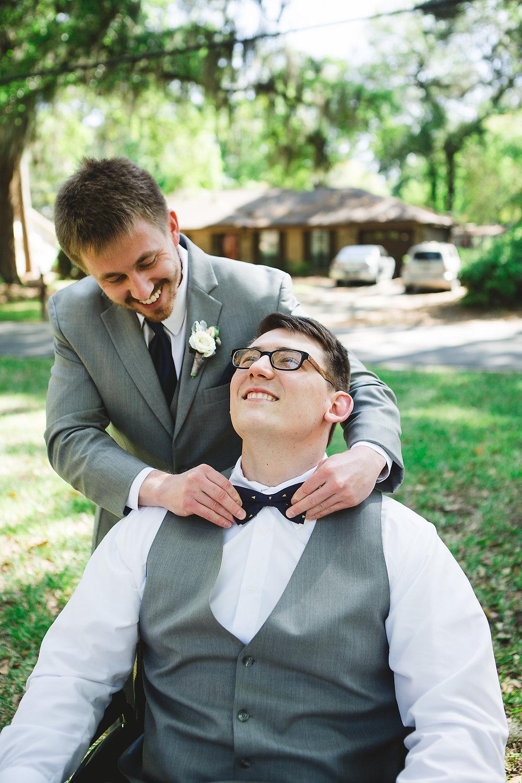 Izzy Hudgins Wedding Photography groomsman adjusting groom's bowtie