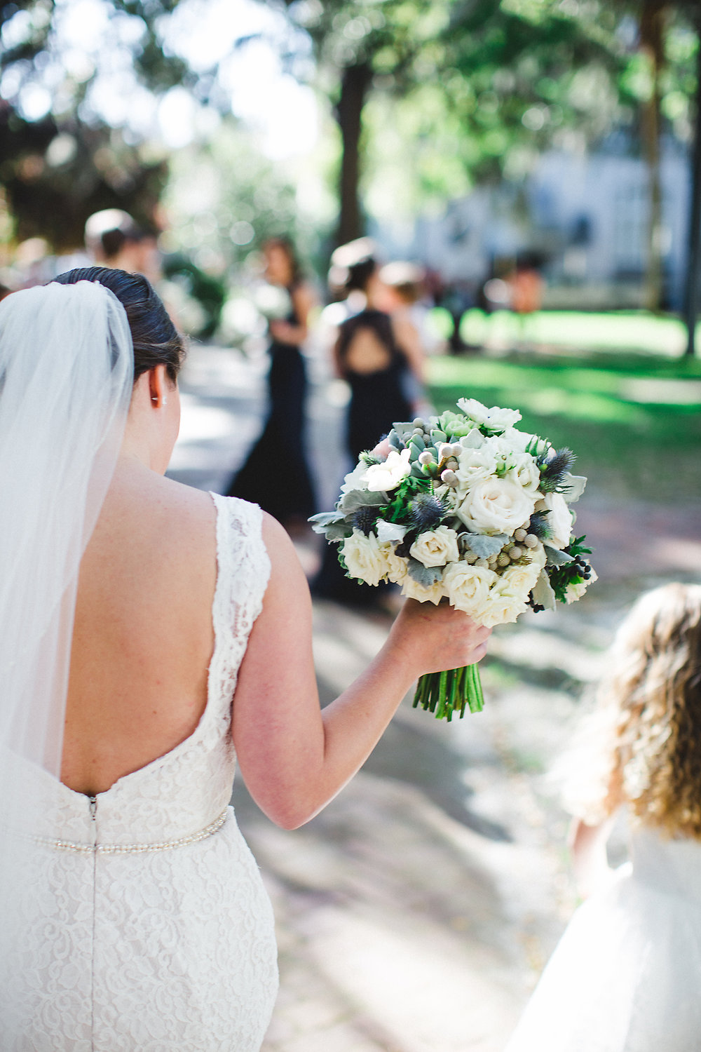 Izzy Hudgins Wedding Photography bride and flower girl from behind