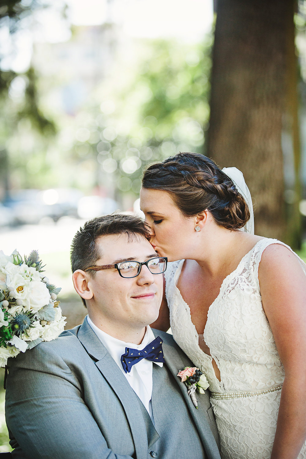 Izzy Hudgins Wedding Photography bride kissing groom's forehead