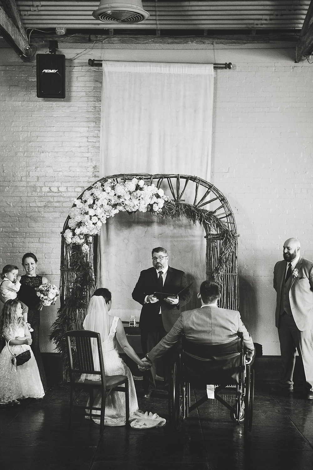 Izzy Hudgins Wedding Photography couple at altar, bride also sitting on chair