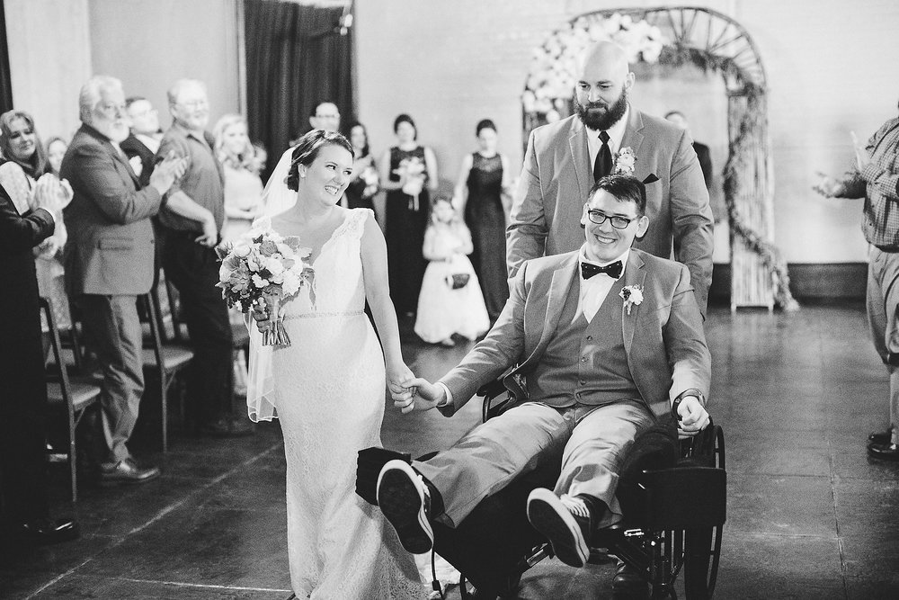 Izzy Hudgins Wedding Photography procession down the aisle, best man pushing groom's wheelchair