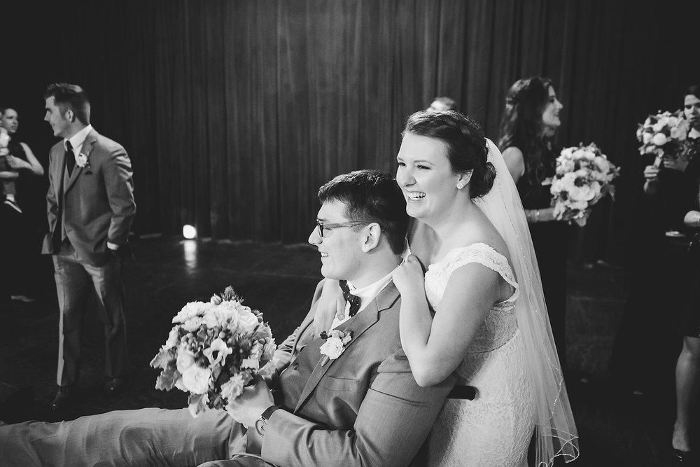 Izzy Hudgins Wedding Photography bride hugging groom's shoulders