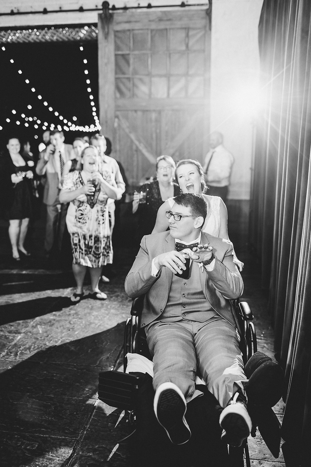 Izzy Hudgins Wedding Photography bride pushing groom in chair
