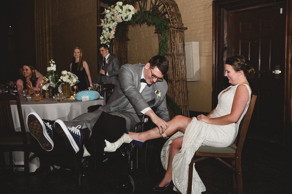 Izzy Hudgins Wedding Photography groom removing garter