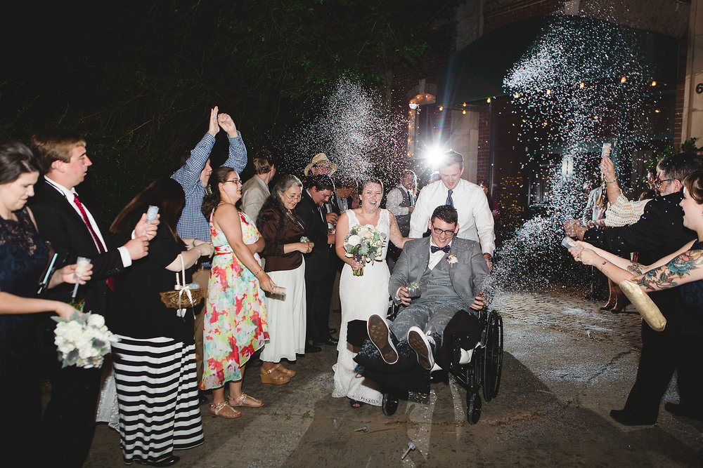 Izzy Hudgins Wedding Photography couple showered with confetti