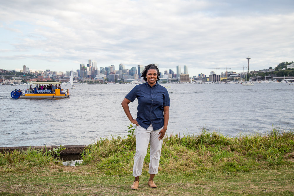 Taymah standing against the Seattle skyline
