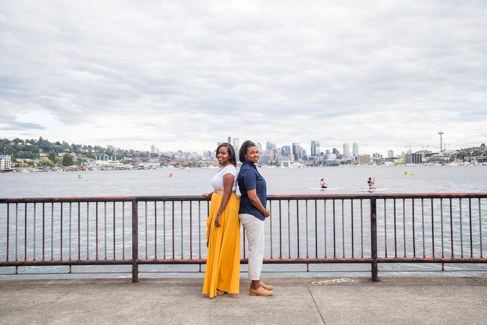 Taymah and Brittany standing against the Seattle skyline in Gas Works Park - Photo by DBK Photography