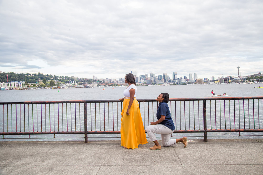 Taymah and Brittany surprise proposal against the Seattle skyline - Photo by DBK Photography