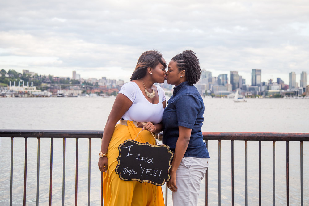 Taymah and Brittany kissing after surprise proposal and engagement - Photo by DBK Photography