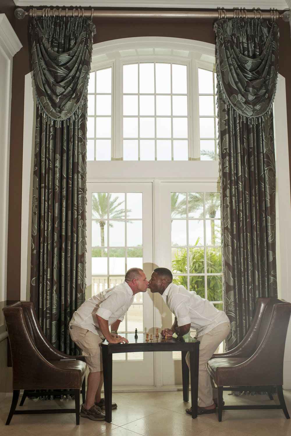 The Canovas Photography kiss across table
