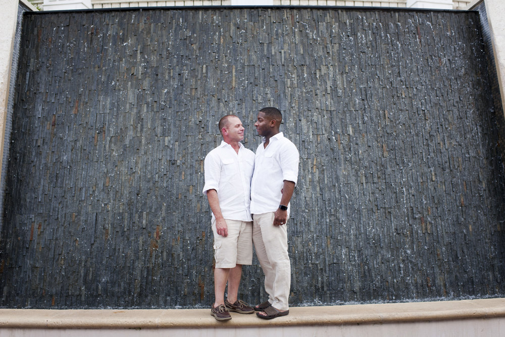 The Canovas Photography grooms by textured wall