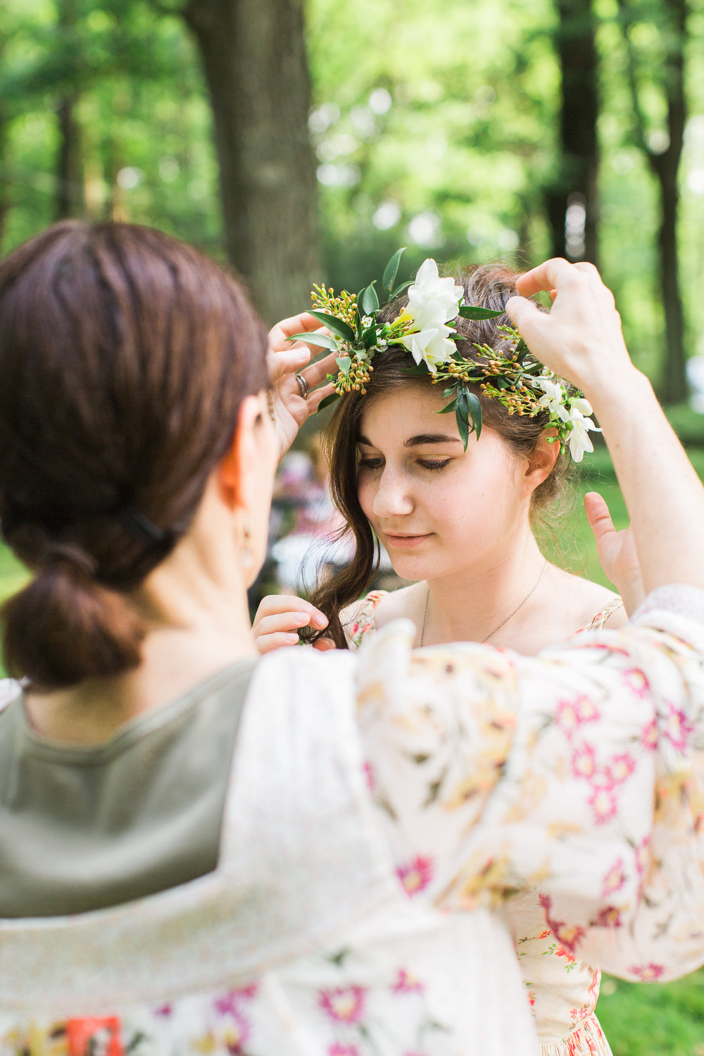Chelo Keys Wedding Photography New Jersey guest putting flower crown on friend