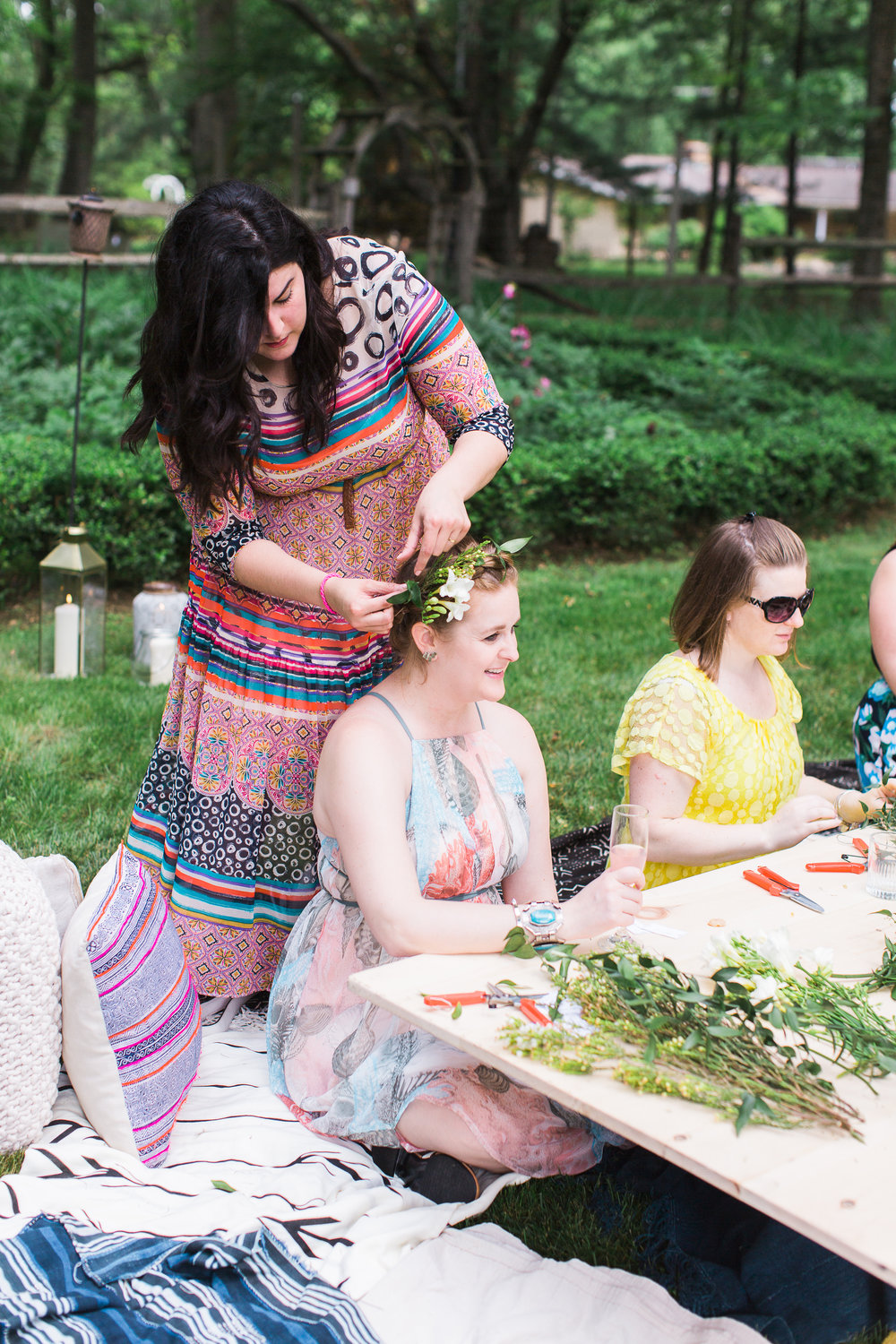 Chelo Keys Wedding Photography New Jersey guest arranging flower crown for friend