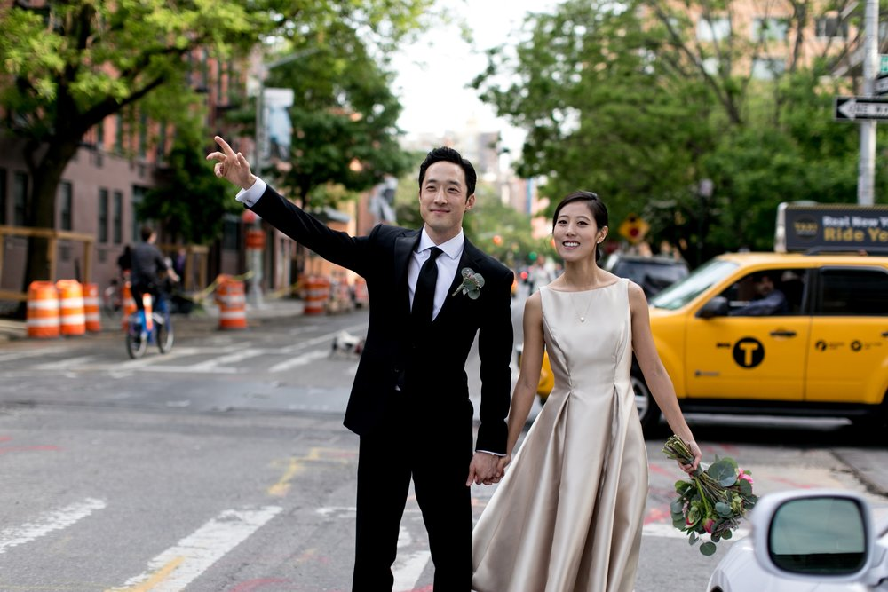Leonard + Michelle Wedding hailing taxi cab by Brookelyn Photography