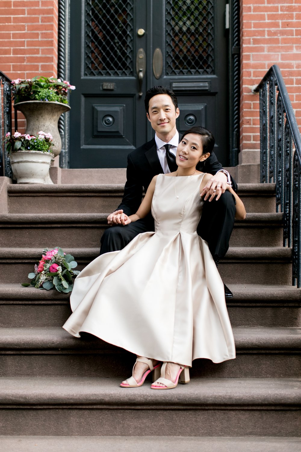 Leonard + Michelle Wedding sitting on brownstone steps by Brookelyn Photography
