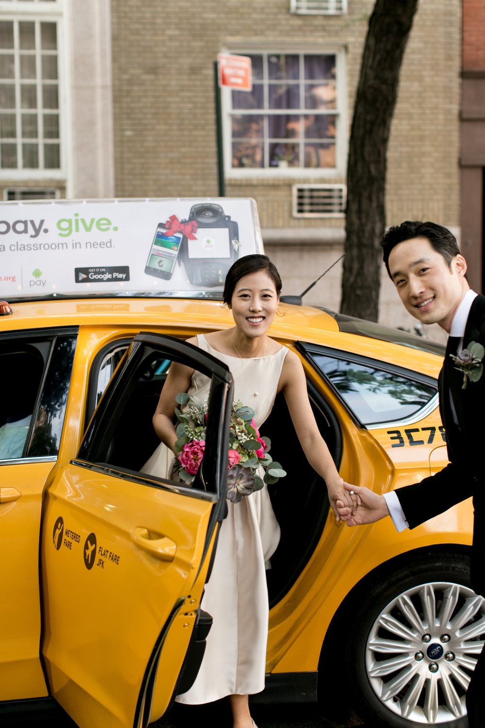 Leonard + Michelle Wedding leaving taxi cab by Brookelyn Photography